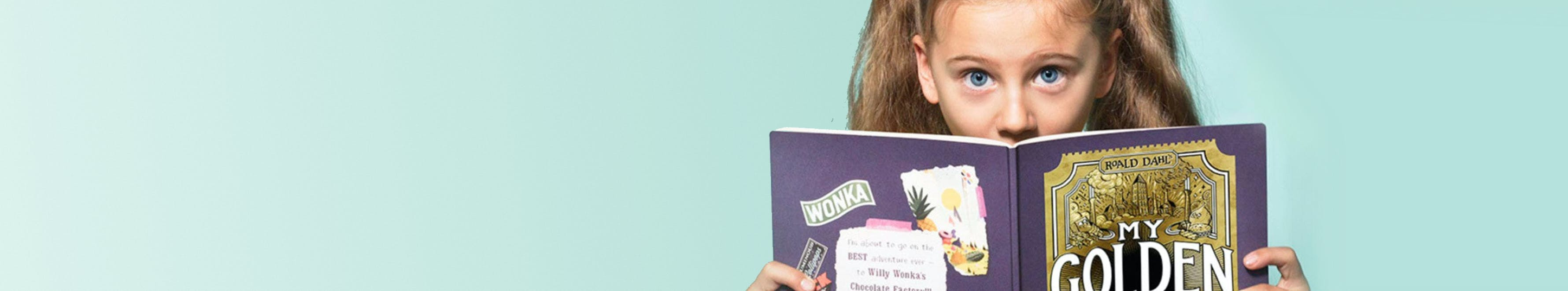 Young girl in awe, reading My Golden Ticket